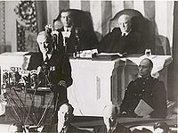 "President Roosevelt delivers his ""Day of Infamy"" speech 12/8/1941. (Wikipedia image). Within an hour after thespeech, Congress declared war on Japan."