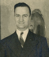 Will Gartz, who wrote the P.S. (note oval photo behind him: that's of Lisi's father and brother, both called Sam